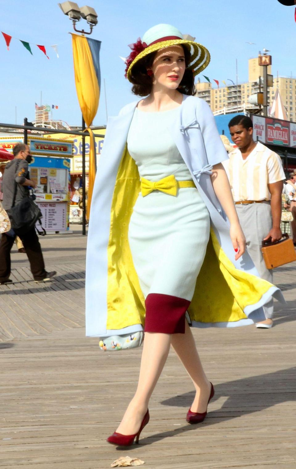 <p>Brosnahan looked chic in a blue-and-yellow ensemble while filming at Coney Island on May 7. </p>