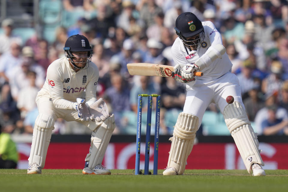 India's Jasprit Bumrah plays a shot off the bowling of England's Moeen Ali on day four of the fourth Test match at The Oval cricket ground in London, Sunday, Sept. 5, 2021. (AP Photo/Kirsty Wigglesworth)