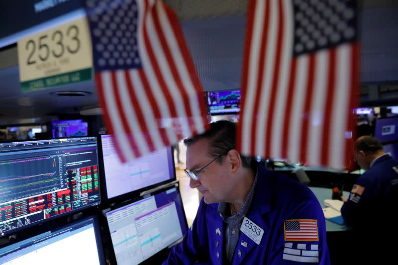 Traders works at the New York Stock Exchange (NYSE) in Manhattan, New York City
