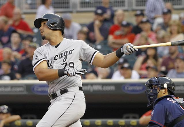 Chicago White Sox's Jose Abreu follows through on a three-run home run off Minnesota Twins starting pitcher Kevin Correia during the first inning of a baseball game in Minneapolis, Friday, July 25, 2014. (AP Photo/Ann Heisenfelt)