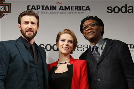 """File photo of cast members Evans, Johansson and Jackson pose at the French premiere of the film """"Captain America: The Winter Soldier"""" in Paris"""