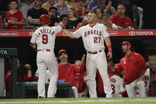 Los Angeles Angels' Tommy La Stella, left, celebrates his two-run home run with Mike Trout during the second inning of a baseball game against the Milwaukee Brewers, Monday, April 8, 2019, in Anaheim, Calif. (AP Photo/Jae C. Hong)