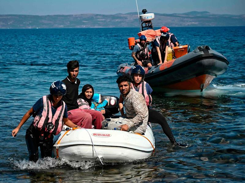 Migrants helped by rescuers arrive on the Greek island of Lesbos after crossing the Aegean Sea from Turkey: AFP/Getty