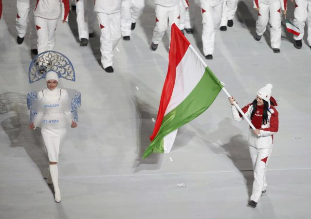Hungary's flag-bearer Bernadett Heidum leads her country's contingent during the opening ceremony of the 2014 Sochi Winter Olympics, February 7, 2014. REUTERS/Lucy Nicholson (RUSSIA - Tags: OLYMPICS SPORT)