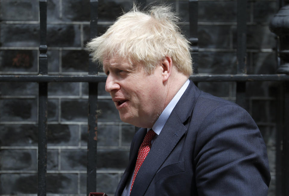 Britain's Prime Boris Johnson leaves 10 Downing Street to attend the weekly Prime Minister's Questions session, in parliament in London, Wednesday, July 15, 2020. (AP Photo/Frank Augstein)