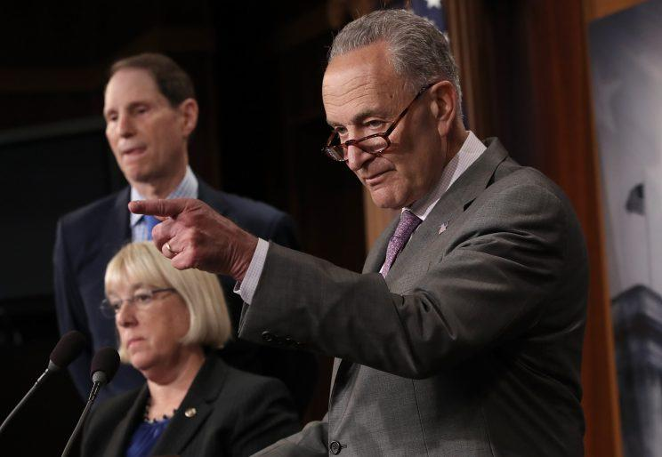 Senate Minority Leader Chuck Schumer, D-N.Y., right, accompanied by Sen. Ron Wyden, D-Ore., and Sen. Patty Murray, D-Wash., answers questions during a press conference at the Capitol on July 13, 2017, in Washington, D.C. (Photo: Win McNamee/Getty Images)
