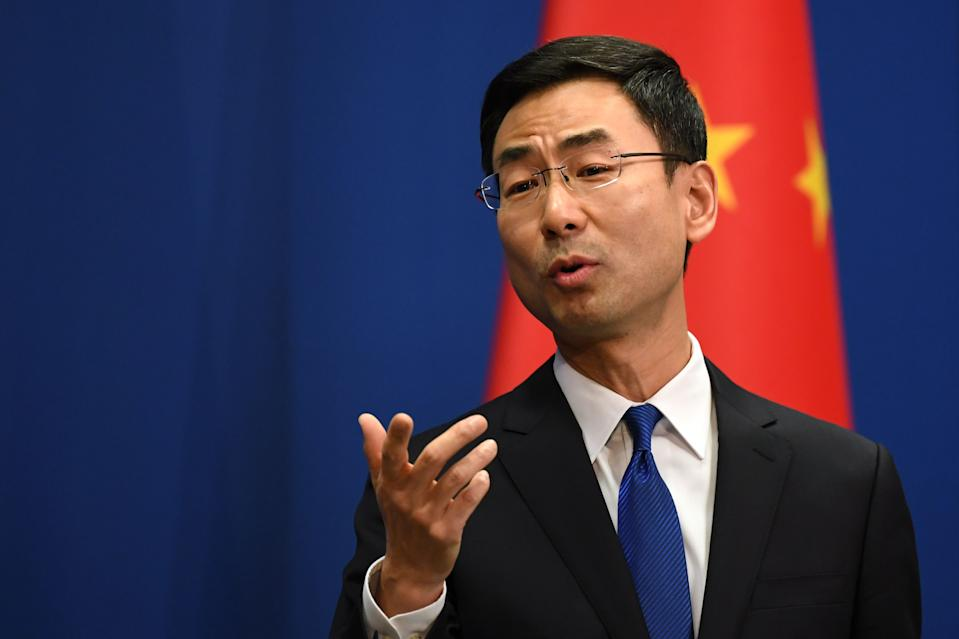 Chinese Foreign Ministry spokesman Geng Shuang speaks during the daily press briefing in Beijing on March 18, 2020. - China on March 18 announced it would expel American journalists from three major US newspapers in one of the communist government's biggest crackdowns on the foreign press, escalating a bitter row over media freedoms. (Photo by GREG BAKER / AFP) (Photo by GREG BAKER/AFP via Getty Images)