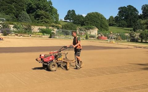Sir Michael Hintze's grass tennis court under construction in the Cotswolds, by specialists Fineturf