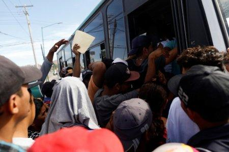 A group of Central American migrants, moving in a caravan through Mexico, get on a microbus to get to the office of Mexico's National Institute of Migration to start the legal process and get temporary residence status for humanitarian reasons, in Hermosillo, Sonora state, Mexico April 24, 2018. REUTERS/Edgard Garrido