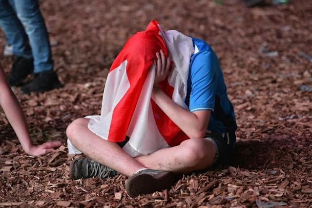 England fans in Paris are disappointed after their team lost the football match against Iceland on June, 27, 2016 (AFP Photo/Bertrand Guay)