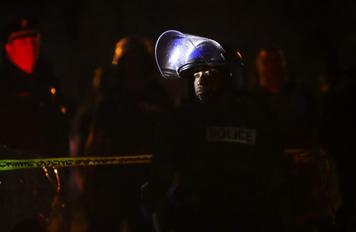 Memphis police maintain a perimeter around the crime scene after protesters took to the streets of the Frayser community in anger against the shooting of a youth by U.S. Marshals earlier in the evening, Wednesday, June 12, 2019, in Memphis, Tenn. Dozens of protesters clashed with law enforcement, throwing stones and tree limbs until authorities broke up the angry crowd with tear gas. (Photo: Mark Weber/Daily Memphian via AP)