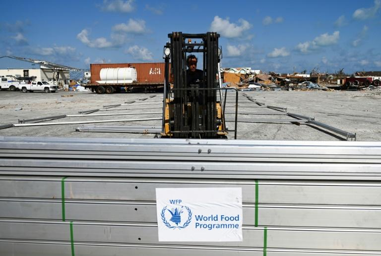 A World Food Programme worker unloads aid at Marsh Harbour airport (AFP Photo/ANDREW CABALLERO-REYNOLDS)