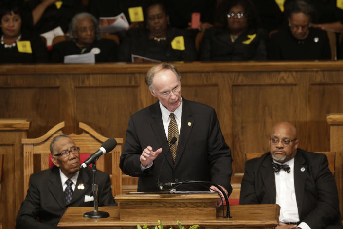 Alabama Gov. Robert Bentley addresses the congregation at the 16th Street Baptist Church in Birmingham, Ala., Sunday, Sept. 15, 2013. The church held a ceremony honoring the memory of the four young girls who were killed by a bomb placed outside the church 50 years ago by members of the Ku Klux Klan. (AP Photo/Dave Martin)