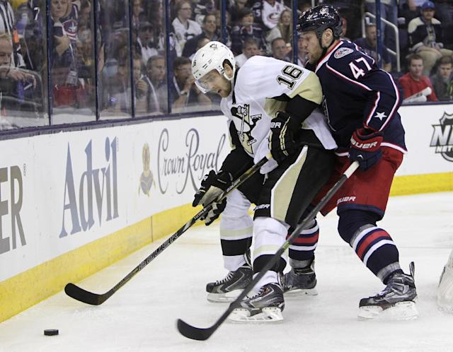 Pittsburgh Penguins' Brandon Sutter, left, keeps the puck away from Columbus Blue Jackets' Dalton Prout during the third period of a first-round NHL playoff hockey game Monday, April 21, 2014, in Columbus, Ohio. The Penguins defeated the Blue Jackets 4-3. (AP Photo/Jay LaPrete)