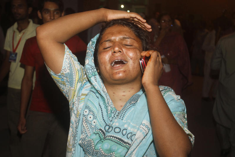 A woman mourns the death of her family member in a factory fire, at a local hospital in Lahore, Pakistan on Tuesday, Sept 11, 2012. A fire that broke out in a factory in eastern Pakistan on Tuesday after sparks from a generator hit chemicals used to make shoes killed dozens of people, a Pakistani police officer said. (AP Photo/K.M. Chaudary)