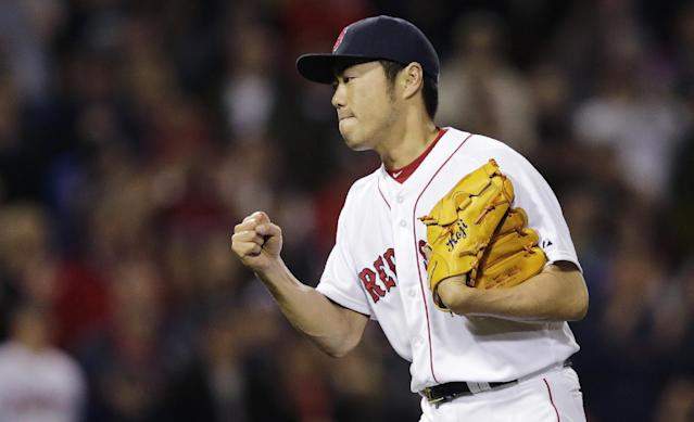 Boston Red Sox relief pitcher Koji Uehara pumps his fist after getting the save in a 5-2 win against the Cleveland Indians during a baseball game at Fenway Park in Boston, Thursday, June 12, 2014. (AP Photo/Charles Krupa)