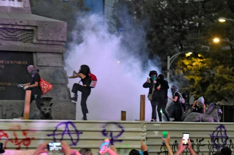 Activists vandalise a monument in Mexico City