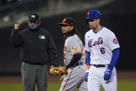 New York Mets' Jeff McNeil (6) walks away after being tagged out at second base by Baltimore Orioles' Freddy Galvis (2) during the third inning of a baseball game Tuesday, May 11, 2021, in New York. (AP Photo/Frank Franklin II)