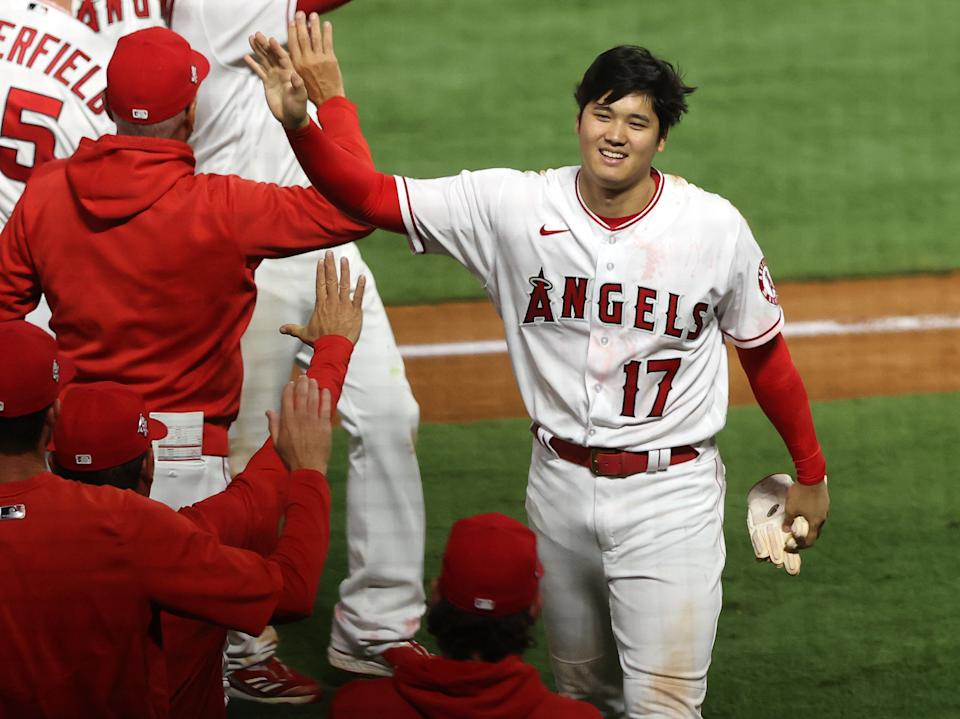 ANAHEIM, CALIFORNIA - JULY 02:  Shohei Ohtani #17 of the Los Angeles Angels celebrates after defeating the Baltimore Orioles 8-7 in the ninth inning at Angel Stadium of Anaheim on July 02, 2021 in Anaheim, California. (Photo by Ronald Martinez/Getty Images)