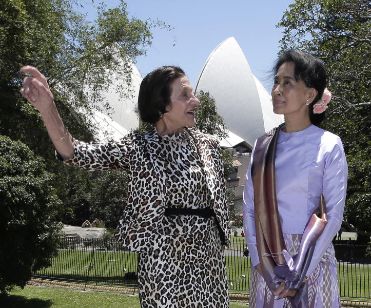 Myanmar pro-democracy leader Aung San Suu Kyi, right, poses with New South Wales state governor Marie Bashir at Government House in Sydney, Wednesday, Nov. 27, 2013. The National League for Democracy lawmaker is on a five-day trip to Sydney, Melbourne and Canberra and will make a number of speeches. (AP Photo/Rick Rycroft)