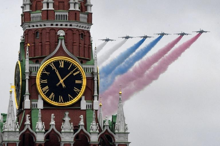 Russian Sukhoi Su-25 assault aircrafts release smoke in the colors of the Russian flag during the Victory Day military parade on May 9, 2021 amid renewed efforts with the United States on arms control