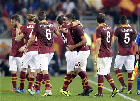 AS Roma's Marco Borriello (3rd R) celebrates with his team mates after scoring against Chievo Verona during their Italian Serie A soccer match at the Olympic stadium in Rome October 31, 2013. REUTERS/Max Rossi