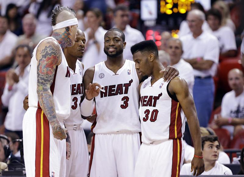 From left, Miami Heat forward Chris Andersen, guard Ray Allen, guard Dwyane Wade and guard Norris Cole huddle during the second half of Game 2 of their NBA basketball playoff series in the Eastern Conference semifinals against the Chicago Bulls, Wednesday, May 8, 2013, in Miami. The Heat won 115-78. (AP Photo/Lynne Sladky)