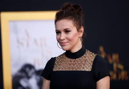 "FILE PHOTO: Alyssa Milano arrives for the premiere of the movie ""A Star Is Born"" in Los Angeles, California, U.S. September 24, 2018. REUTERS/Mario Anzuoni/File Photo"
