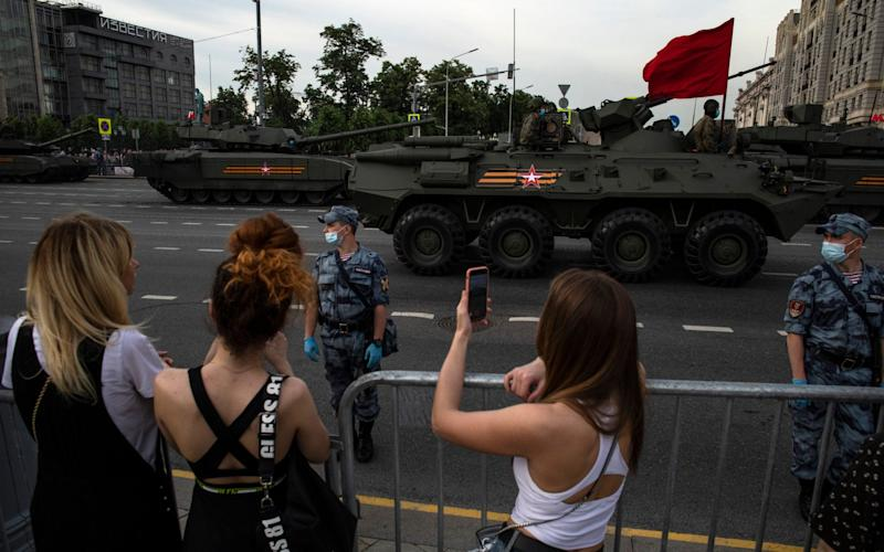 Tanks and other military hardware drove through Moscow on Wednesday for a parade rehearsal - Pavel Golovkin/AP