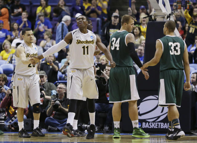 Wichita State guard Fred VanVleet (23) and Cleanthony Early (11) celebrate as Cal Poly forward Brian Bennett (34) and forward Chris Eversley (33) reset during the first half of a second-round game in the NCAA college basketball tournament Friday, March 21, 2014, in St. Louis. (AP Photo/Jeff Roberson)