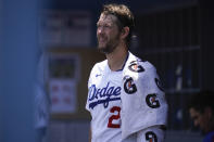 Los Angeles Dodgers starting pitcher Clayton Kershaw (22) ices his left arm in the dugout in the bottom of the first inning of a baseball game against the San Francisco Giants Sunday, May 30, 2021, in Los Angeles. (AP Photo/Ashley Landis)