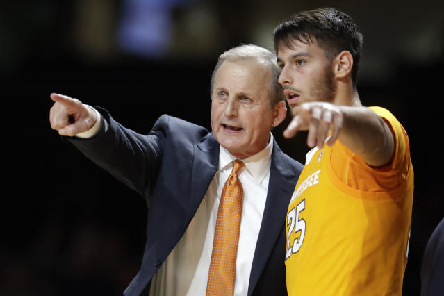 FILE - In this Saturday, Jan. 18, 2020, file photo, Tennessee coach Rick Barnes talks with guard Santiago Vescovi during the second half of the team's NCAA college basketball game against Vanderbilt in Nashville, Tenn. Vescovi, from Uruguay, is one of several international players on the Tennessee team, which also has players from France, Serbia and Finland. With competition canceled across all NCAA divisions because of the new coronavirus, many of these international athletes face a dilemma. Their campuses are shut down, but the coronavirus situation in their homeland may be worse than it is in the United States. (AP Photo/Mark Humphrey, File)