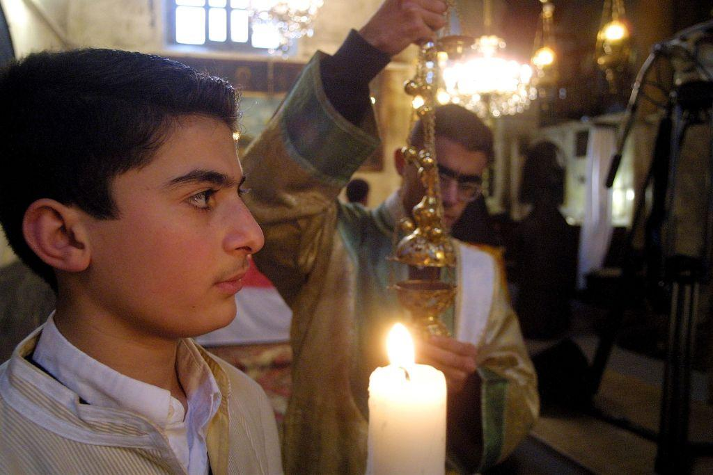 BETHLEHEM, WEST BANK:  Armenian priests make the last preparations before the noon service in the Church of the Nativity. File photo: 2003