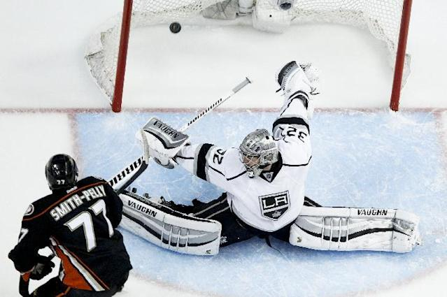 Anaheim Ducks right wing Devante Smith-Pelly srcores past Los Angeles Kings goalie Jonathan Quick during the second period in Game 5 of an NHL hockey second-round Stanley Cup playoff series in Anaheim, Calif., Monday, May 12, 2014. (AP Photo/Chris Carlson)