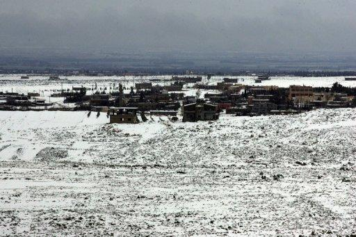 <p>View from the Lebanese border shows snow covering the ground in the Syrian town of Heet, on March 1, 2012. Israel forces have carried out an air strike overnight on a weapons convoy from Syria near the Lebanese border, security sources tell AFP.</p>