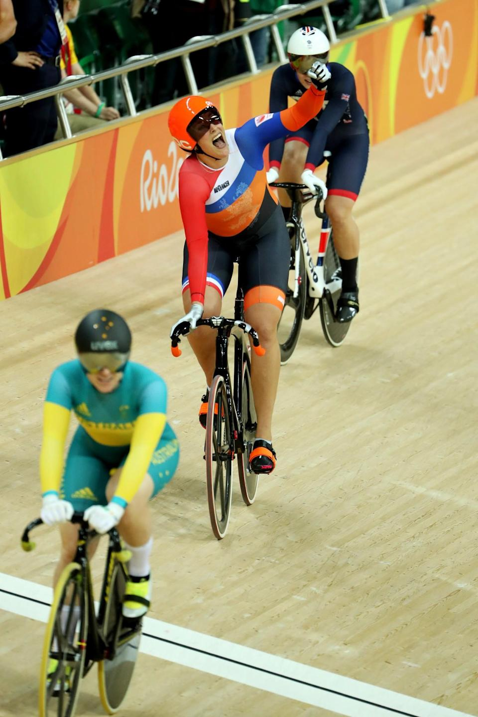 <p>Elis Ligtlee (C) of the Netherlands celebrates winning the gold medal in the during the Women's Keirin Final on Day 8 of the Rio 2016 Olympic Games at the Rio Olympic Velodrome on August 13, 2016 in Rio de Janeiro, Brazil. (Photo by Christian Petersen/Getty Images) </p>