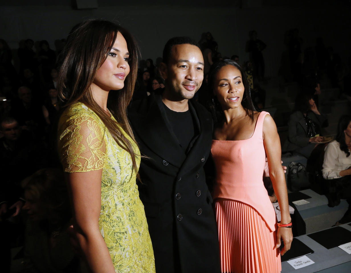 Model Chrissy Teigen, singer John Legend and actress Jada Pinkett Smith pose together before the Vera Wang Autumn/Winter 2013 collection during New York Fashion Week, February 12, 2013.   REUTERS/Brendan McDermid (UNITED STATES - Tags: FASHION ENTERTAINMENT) - RTR3DP94