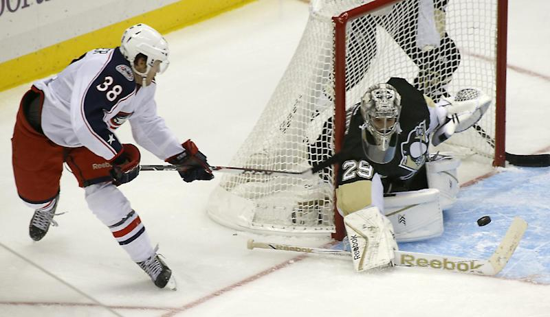 Columbus Blue Jackets' Boone Jenner, left, scores the go-ahead goal on Pittsburgh Penguins goalie Marc-Andre Fleury in the third period of the NHL hockey preseason game on Saturday, Sept. 21, 2013, in Pittsburgh. The Blue Jackets won 5-3.(AP Photo/Keith Srakocic)