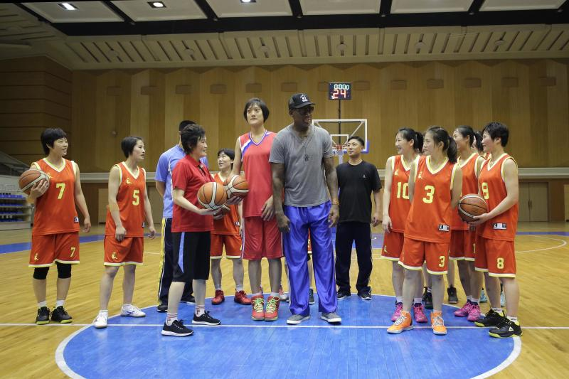 "Dennis Rodman talks to the North Korea's women's basketball team during his visit to Pyongyang, North Korea, in 2017. Rodman began sightseeing in Pyongyang on Wednesday during a trip he said he hoped would ""open a door"" for President Donald Trump."