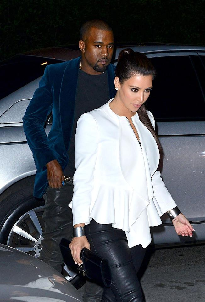 "Kim Kardashian was ""scheming to cheat on Kanye West"" with incoming NFL player Robert Griffin III, reveals <i>MediaTakeOut.</i> The site says Kardashian met Griffin at a ""30 Rock"" taping, and instantly became ""intrigued"" by the pro athlete. For what Kardashian tried to do to hook up with Griffin, and how furious West became when he find out, go to <a target=""_blank"" href=""http://www.gossipcop.com/kim-kardashian-robert-griffin-iii-cheating-kanye-west-30-rock-jack-burditt-interview-nfl-player/"">Gossip Cop</a>."