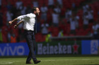 England's manager Gareth Southgate celebrates his side's 1-0 win at the end of the Euro 2020 soccer championship group D match between England and Croatia, at Wembley stadium, London, Sunday, June 13, 2021. (Laurence Griffiths, Pool via AP)