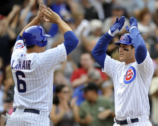 Chicago Cubs' Anthony Rizzo, right, celebrates with teammate Bryan LaHair left, at home plate after hitting a grand slam in the sixth inning during a baseball game against the Pittsburgh Pirates in Chicago, Sunday, Sept. 16, 2012. (AP Photo/Paul Beaty)