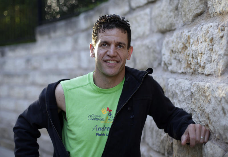 Marathon runner Joe Berti poses for a photo in Austin, Texas, Thursday, April 18, 2013. Berti had just finished the Boston Marathon seconds before two bombs exploded at the finish line. Two days later, he was in his home state of Texas when he saw a fertilizer plant explode near Waco. (AP Photo/Eric Gay)