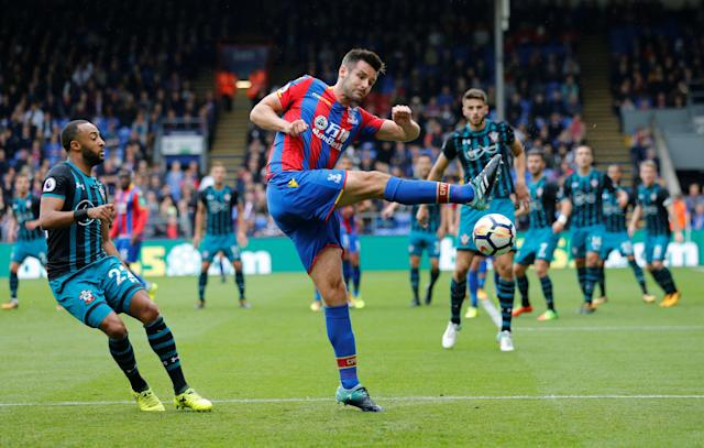 <p>Scott Dann in action in action with Southampton's Nathan Redmond REUTERS/David Klein </p>