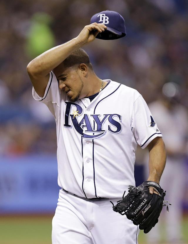 Tampa Bay Rays relief pitcher Joel Peralta reacts after being taken out of the game against the Cleveland Indians during the seventh inning of a baseball game Friday, May 9, 2014, in St. Petersburg, Fla. (AP Photo/Chris O'Meara)