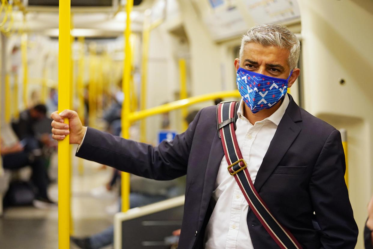 Mayor of London Sadiq Khan wears a mask as he rides on a Circle Line train on the Underground to visit the London Transport Museum. Picture date: Wednesday July 14, 2021.