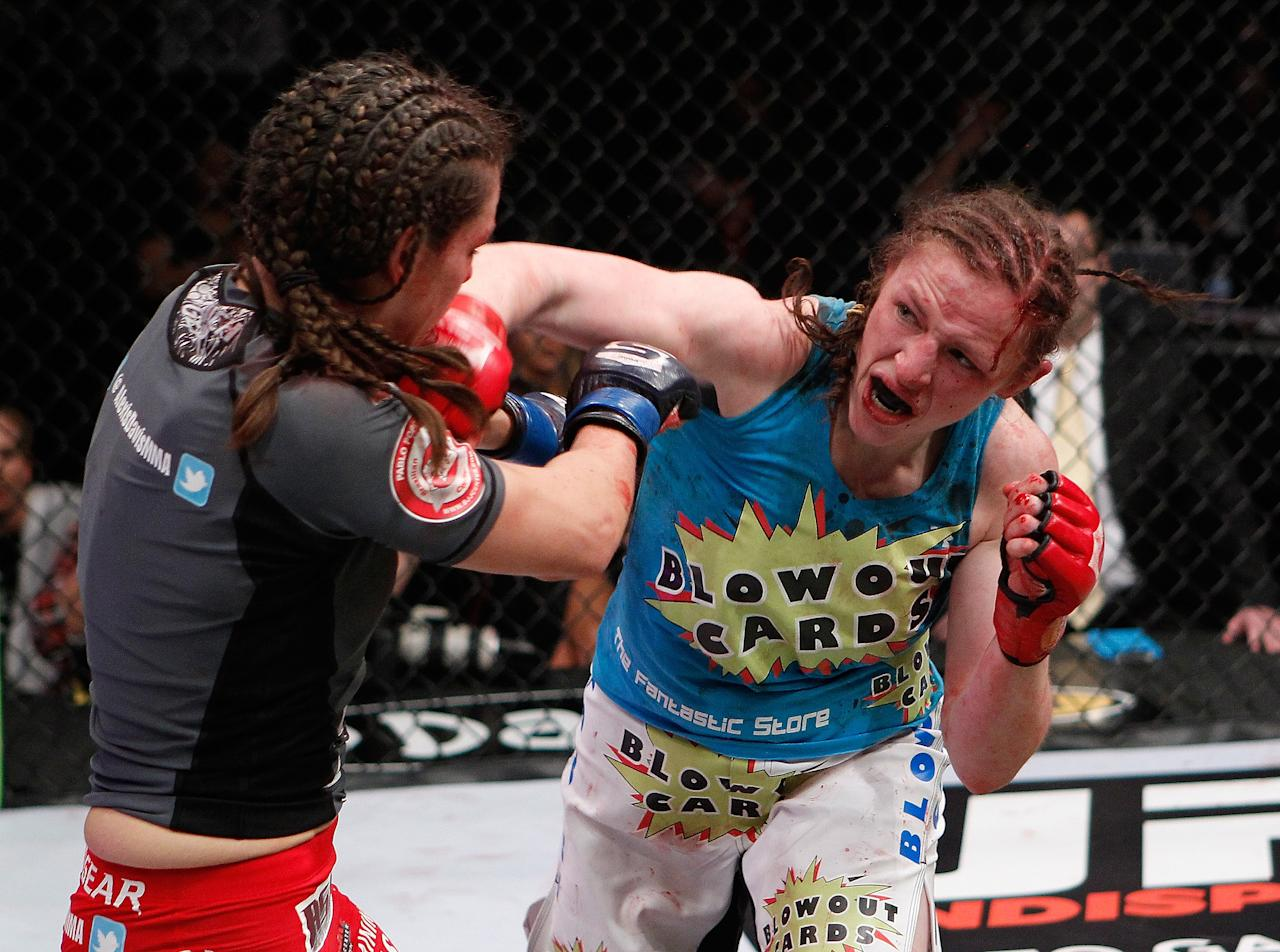 COLUMBUS, OH - MARCH 03: Sarah Kaufman (right) throws a punch at Alexis Davis (left) during the Strikeforce event at Nationwide Arena on March 3, 2012 in Columbus, Ohio. (Photo by Esther Lin/Forza LLC/Forza LLC via Getty Images)