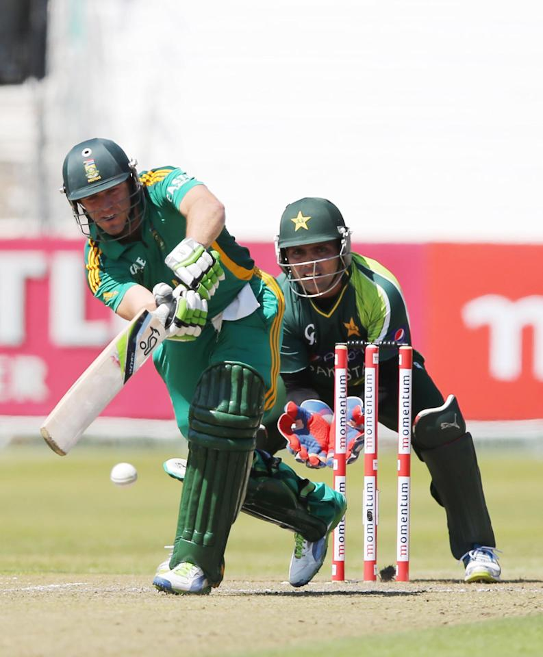 DURBAN, SOUTH AFRICA - MARCH 21:  AB de Villiers of South Africa bats as wicketkeeper Kamran Akmal looks on during the 4th Momentum One Day International match between South Africa and Pakistan at Sahara Stadium Kingsmead on March 21, 2013 in Durban, South Africa.  (Photo by Anesh Debiky/Gallo Images/Getty Images)