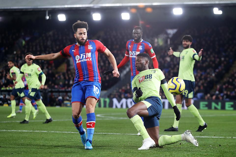 LONDON, ENGLAND - DECEMBER 03: Andros Townsend of Crystal Palace (L) is challenged by Jefferson Lerma of AFC Bournemouth during the Premier League match between Crystal Palace and AFC Bournemouth at Selhurst Park on December 03, 2019 in London, United Kingdom. (Photo by Jack Thomas/Getty Images)