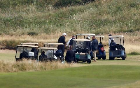 U.S. President Donald Trump stands on the course of his golf resort, in Turnberry - Credit: Reuters
